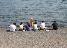 Asain Familie auf Strand Lizenzfreie Stockbilder