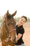 Asain girl. A pretty asain girl with horse in a farm Stock Photography