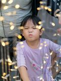 Asain girl with funny face and Chrismas lightihng decoration royalty free stock image