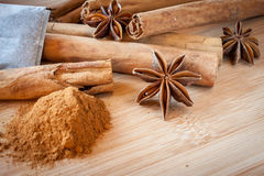 Asain Spice. Ground and stick cinnamon, tea, and star anise on a bamboo surface Royalty Free Stock Images