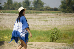Asain thai women travelers visit and posing with rice field Royalty Free Stock Photography