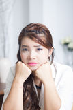 Feeling unhappy. Asian womans face feeling unhappy Royalty Free Stock Image