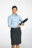 Asain woman  holding folio. Young Asian Business woman photographed over white Royalty Free Stock Images