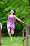 Asain woman jumping on bridge Royalty Free Stock Photography