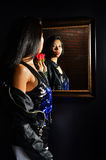 Asain woman looking in a mirror Royalty Free Stock Photos