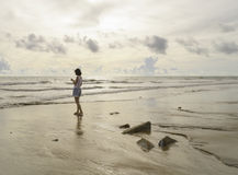 Asain woman stand on the beach Stock Images