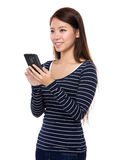 Asain woman use of cellphone Royalty Free Stock Photo