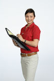 Asain woman  writting Royalty Free Stock Photography