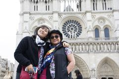 Asain women mother and daughter travel and posing for take photo at Cathedrale Notre-Dame de Paris Royalty Free Stock Image