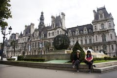 Asain women mother and daughter travel and posing for take photo with Hotel de Ville Royalty Free Stock Photos