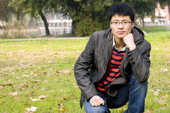 Asain young man in park Royalty Free Stock Photos