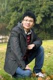 Asain young man in park. Asain young man in autumn park,smile Stock Photos