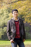 Asain young man in park Stock Photo