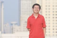 Asain young man smiles Stock Photo