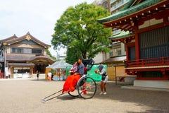 Asakusa Shrine Asakusa-jinja is a Shinto shrine. Rickshaw guide makes photo. Tradition and modernity stock photos