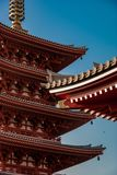 Asakusa shrine roof awning detail - with dawn light reflecting. Close up of the awnings at Asakusa shrine, Tokyo, which is well worht a visit if you are in town royalty free stock images