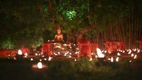 Asalha Bucha Day ,Chiangmai Thailand. CHIANG MAI THAILAND - JUL 19 : Asalha Bucha Day is the important incidents Buddhist day. Buddhist monk light candles to the stock video