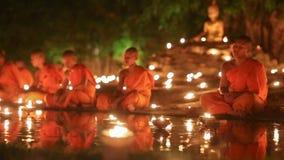 Asalha Bucha Day ,Chiangmai Thailand. CHIANG MAI THAILAND - JUL 19 : Asalha Bucha Day is the important incidents Buddhist day. Buddhist monk light candles to the stock footage