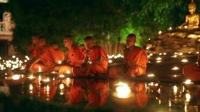 Asalha Bucha Day, Chiangmai, Thailand. CHIANG MAI THAILAND - JUL 19 : Asalha Bucha Day is the important incidents Buddhist day. Buddhist monk light candles to stock footage
