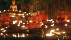 Asalha Bucha Day, Chiangmai, Thailand. CHIANG MAI THAILAND - JUL 19 : Asalha Bucha Day is the important incidents Buddhist day. Buddhist monk light candles to stock video footage