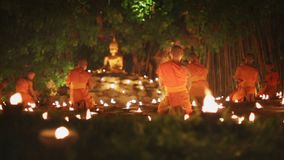 Asalha Bucha Day, Chiangmai, Thailand. Asalha Bucha Day is the important incidents Buddhist day. Buddhist monk light candles to the Buddha stock video footage