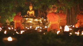 Asalha Bucha Day, Chiangmai, Thailand. Asalha Bucha Day is the important incidents Buddhist day. Buddhist monk light candles to the Buddha stock video