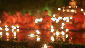 Asalha Puja Day , Chiang mai , Thailand. Asalha Puja Day , Monks light candles and pray to buddha statue in Phan tao temple , Chiang mai , Thailand stock video footage