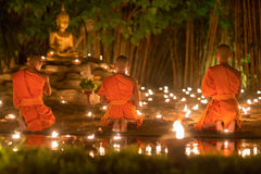 Asalha Puja Day ,Monks pray to buddha statue . Royalty Free Stock Photography