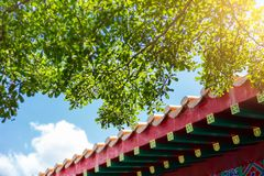 Chinese roof style building with green tree clean air fresh blue sky. china eco sustainable city concept. Asan chinese style building with green tree clean air royalty free stock photos
