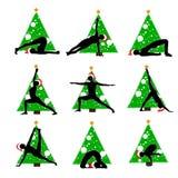 Asanas da ioga do ano novo do Natal imagens de stock royalty free