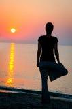 Asanas at sunset Royalty Free Stock Image