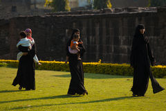 Asar Mahal Ruins Park Muslim Family Bijapur. BIJAPUR, INDIA - FEBRUARY 20, 2009: Unidentified Indian muslim women spend a pleasant afternoon around the ruins of stock image