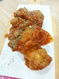 Asas de frango fritas Imagem de Stock