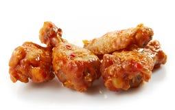 Asas de frango frito com molho de pimentão doce Foto de Stock