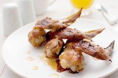 Asas de galinha do restaurante com molho alaranjado do citrino Foto de Stock