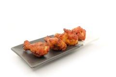 Asas de galinha picantes Foto de Stock