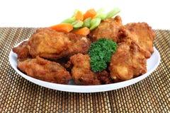 Asas e vegetais de galinha Foto de Stock Royalty Free