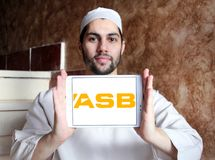 ASB Bank logo. Logo of ASB Bank on samsung tablet holded by arab muslim man. ASB is a bank owned by Commonwealth Bank, operating in New Zealand. It provides a Stock Photos