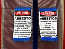 Asbestminskningtecken royaltyfria foton