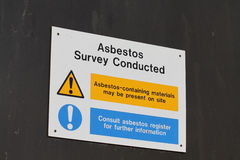 Asbestos. Sign warning of possible asbestos contamination and danger to health