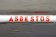 Asbestos. Manditory labeling of the Asbestos wraped water lines through out the old Roseburg Oregon fire Station Royalty Free Stock Photography