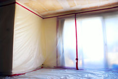 Asbestos Abatement. Room covered with clear plastic sheeting after asbestos abatement completed on popcorn ceiling Stock Images