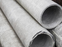 Asbestos-cement or concrete drainage pipes for industrial building construction. Stock Image