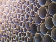 Asbestos cement pipes used for drainage construction. Texture for background. Asbestos cement pipes used for drainage construction Royalty Free Stock Images