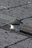 Asbestos. Conical vent chimney on asbestos rooftop of an old warehouse.(Concept of public health danger Royalty Free Stock Photos