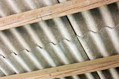 Asbestos cover. Asbestos cement panels - wavy roof cover on pollutant eternit  panels Stock Photo