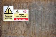 Asbestos. Danger asbestos sign on boarded up building Royalty Free Stock Photo