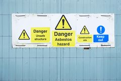 Asbestos hazard danger sign at construction site keep out. Uk royalty free stock images