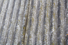 Asbestos old dangerous roof tiles. Royalty Free Stock Photography
