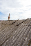 Asbestos old dangerous roof tiles. Royalty Free Stock Image